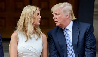 Donald J. Trump speaks with his daughter Ivanka Trump on stage before they participate in a groundbreaking ceremony for the Trump International Hotel, a $200 million redevelopment of the iconic Old Post Office building on Pennsylvania Ave., Washington, D.C., Wednesday, July 23, 2014. (Andrew Harnik/The Washington Times)