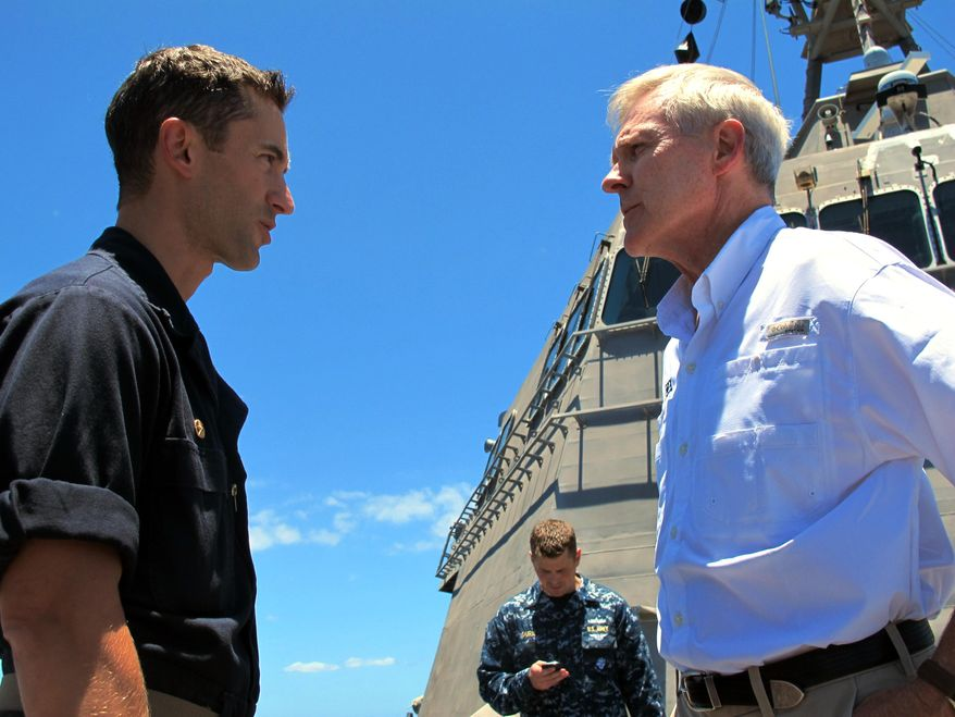 Navy Secretary Ray Mabus (right) speaks to the USS Independence's captain, Cmdr. Joseph Gagliano, on board the ship in waters off Honolulu on July 24, 2014. (Associated Press) **FILE**