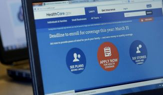 FILE - In this March 31, 2014 file photo, people sign up for the Affordable Care Act at Swope Health Services, in Kansas City, Mo. The Associated Press interviewed insurance agents, health counselors and attorneys around the country who said they received varying subsidy amounts for the same consumers. (AP Photo/Charlie Riedel, File)