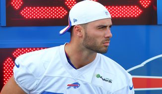 Buffalo Bills Mike Caussin (80) watches the action during their NFL football training camp in Pittsford, N.Y., Monday, Aug. 5, 2013. (AP Photo/Bill Wippert)