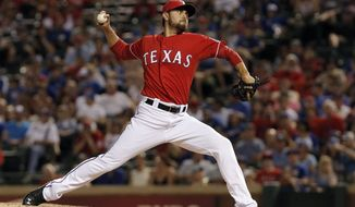 Texas Rangers relief pitcher Joakim Soria (28) during a baseball game against the Cleveland Indians, Friday, June 6, 2014, in Arlington, Texas. Texas won 6-4. (AP Photo/Brandon Wade)