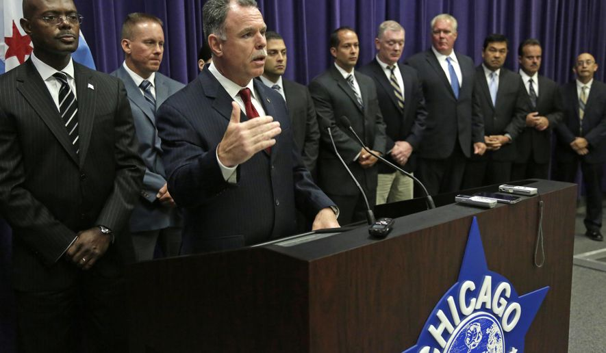 Chicago Police Superintendent Garry McCarthy speaks at a news conference Thursday, July 24, 2014, in Chicago to announce that 18-year-old Tevin Lee has been charged in connection with the slaying of Shamiya Adams, an 11-year-old girl who was struck in the head by a stray bullet Friday, July 18 in Chicago while at a sleepover. She died early the next morning. Tevin Lee was charged with murder, felony murder and aggravated discharge of a firearm. (AP Photo/M. Spencer Green)