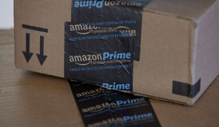 This June 4, 2014 photo shows Amazon.com boxes in Phoenix. Amazon reports quarterly financial results on Thursday, July 24, 2014. (AP Photo/Ross D. Franklin)