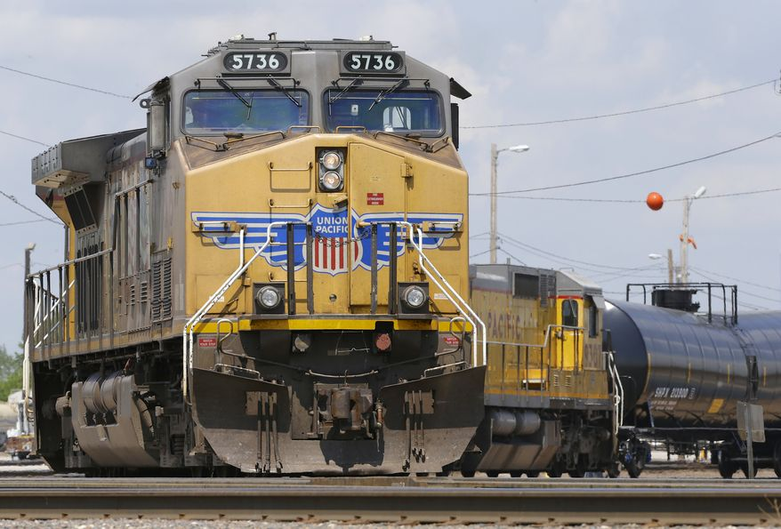In this June 6, 2014 photo, Union Pacific locomotives pull a train in Council Bluffs, Iowa. Union Pacific reports quarterly financial results on Thursday, July 24, 2014. (AP Photo/Nati Harnik)