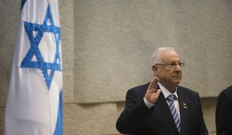 Incoming Israeli President Reuven Rivlin is sworn in during a ceremony at the Knesset, Israel's parliament, in Jerusalem. Despite the recent violence in the region, Jewish youths continue to make pilgrimages to the nation.  (AP Photo/Ronen Zvulun, Pool)