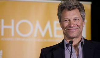 "FILE - This April 22, 2014 file photo shows musician and humanitarian Jon Bon Jovi during the grand opening of the JBJ Soul Homes in Philadelphia.  Jon Bon Jovi will be honored with an award named for an opera singer. The Marian Anderson Award is given in Philadelphia to ""critically acclaimed artists who have impacted society in a positive way."" In announcing the recipient Wednesday, July 23, organizers said Bon Jovi has used his musical success to support groups working to end homelessness and hunger. Bon Jovi will accept the $25,000 award on Nov. 18 at the city's Kimmel Center for the Performing Arts. Anderson was a celebrated contralto and Philadelphia native who in 1955 became the first black soloist at the Metropolitan Opera in New York. She died in 1993 at the age of 96. (AP Photo/Matt Rourke, File)"