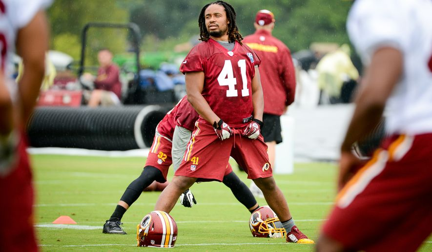 Washington Redskins strong safety Phillip Thomas (41) stretches on the opening day of Washington Redskins Training Camp at Bon Secours Training Center, Richmond, Va., Thursday, July 24, 2014. (Andrew Harnik/The Washington Times)