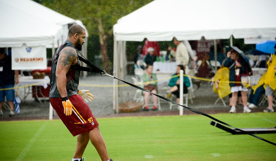 Washington Redskins defensive end Jason Hatcher (97) rehabs on the opening day of Washington Redskins Training Camp at Bon Secours Training Center, Richmond, Va., Thursday, July 24, 2014. (Andrew Harnik/The Washington Times) ** FILE **