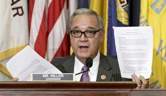 House Veterans Affairs Committee Chairman Jeff Miller, R-Fla., holds up two pages of resource requests from the Department of Veterans Affairs on Capitol Hill in Washington, Thursday, July 24, 2014,  as he questions Department of Veterans Affairs acting secretary Sloan Gibson on how to restore trust to the beleaguered agency. (AP Photo)