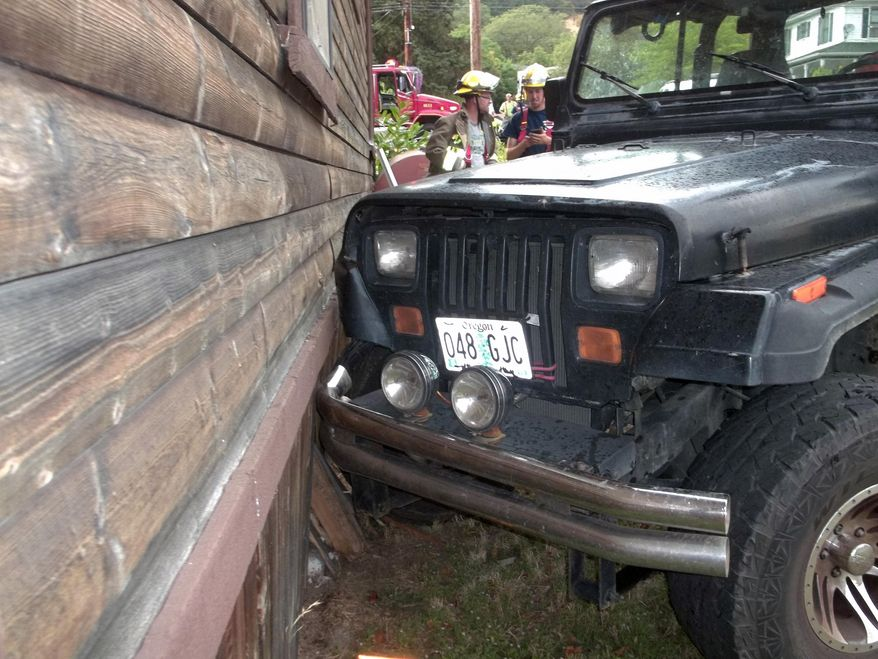 This photo provided by the Myrtle Creek Police Department shows a Jeep that authorities say a toddler crashed into an home in Myrtle Creek, Ore. The 3-year-old boy wearing only a diaper climbed into the Jeep on Tuesday, July 24, 2014, and knocked it out of gear, according to authorities. Witnesses said it rolled down the street, through an intersection and into the house, causing minor damage. After the crash authorities said the toddler ran back to his home to watch cartoons. (AP Photo/Myrtle Creek Police Department)