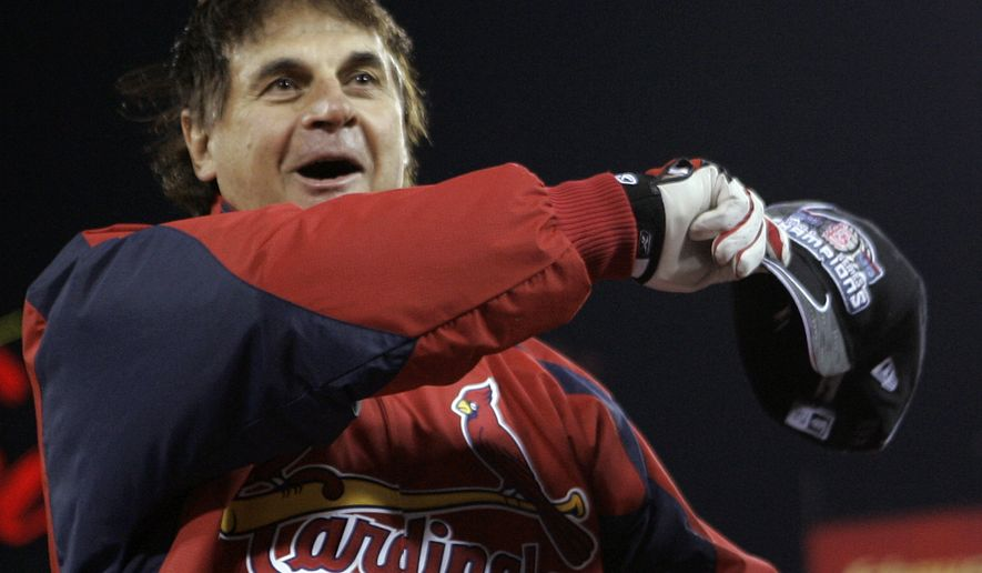 ADVANCE FOR WEEKEND EDITIONS, JULY 26-27 - FILE - In this Oct. 27, 2006 file photo, St. Louis Cardinals manager Tony La Russa waves to spectators before receiving the 2006 World Series trophy after defeating the Detroit Tigers in Game 5 of the World Series in St. Louis. La Russa will be inducted into the Baseball Hall of Fame in Cooperstown, N.Y., on Sunday, July 27, 2014. (AP Photo/Elise Amendola, File)