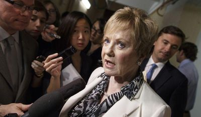 ** FILE ** Rep. Kay Granger, R-Texas, is surrounded by reporters on Capitol Hill in Washington, Friday, July 25, 2014, as she emerges from a closed-door session with fellow Republicans. (AP Photo)