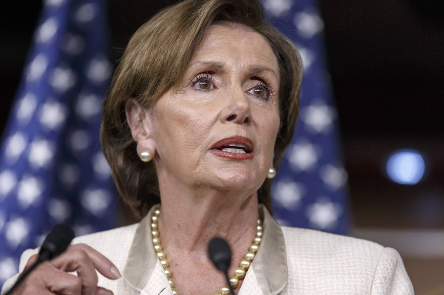 House Minority Leader Nancy Pelosi of Calif., takes questions from reporters on Capitol Hill in Washington, Friday, July 25, 2014. (AP Photo) ** FILE **
