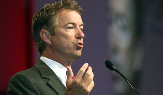 Kentucky Senator Rand Paul talks to attendees at the National Urban League Annual Conference in Cincinnati Friday, July 25, 2014. Paul announced he will introduce legislation that will eliminate federal sentencing disparities between crack and powder cocaine. (AP Photo/Tom Uhlman)