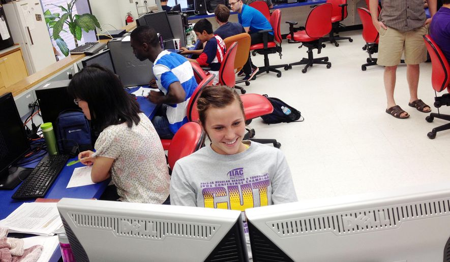 Alexis Hanson, a sophomore from Loras College, works on lab computers July 17, 2014, in the Bowen Science Building at the University of Iowa in Iowa City, Iowa. (AP Photo/Iowa City Press-Citizen, Josh O'Leary) ** FILE **
