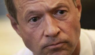 FILE - Maryland Gov. Martin O'Malley speaks with reporters in his office inside the Maryland State House in Annapolis, Md., in this April 7, 2014 file photo. O'Malley was returning to Iowa on Saturday, July 26, 2014 headlining a fundraiser for state Sen. Rita Hart in Clinton, a town on the banks of the Mississippi River, and another event in North Liberty for Kevin Kinney, a Johnson County sheriff's deputy seeking an open state Senate seat. After a Saturday night speech in Omaha to help the Nebraska Democratic Party, O'Malley was joining with Democratic gubernatorial candidate Jack Hatch, who is challenging Republican Gov. Terry Branstad, for fundraisers in western Iowa on Sunday and a canvassing kickoff in Sioux City. (AP Photo/Patrick Semansky, File)