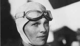 This undated photo shows Amelia Earhart, the first woman to fly solo across the Atlantic Ocean. A piece of an aluminum aircraft discovered on an uninhabited atoll in the southwestern Pacific has been identified as belonging to Earhart's twin-engine Lockheed Electra.  (AP Photo, file)