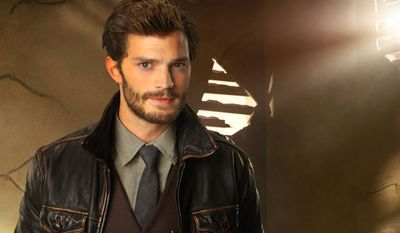 "FILE - In this photo released by ABC on Oct. 24, 2013, actor Jamie Dornan guest stars as Sheriff Graham on ABC's ""Once Upon a Time."" The release of the big-screen adaptation of ""Fifty Shades of Grey"" has been postponed, Universal Pictures announced Wednesday, Nov. 13, 2013. The film had been scheduled to open in August next year, but will now debut on Valentine's Day in 2015. Dornan has been cast as billionaire Christian Grey, the lead role that Charlie Hunnam withdrew from recently. (AP Photo/ABC, Craig Sjodin/Kharen Hill, File)"