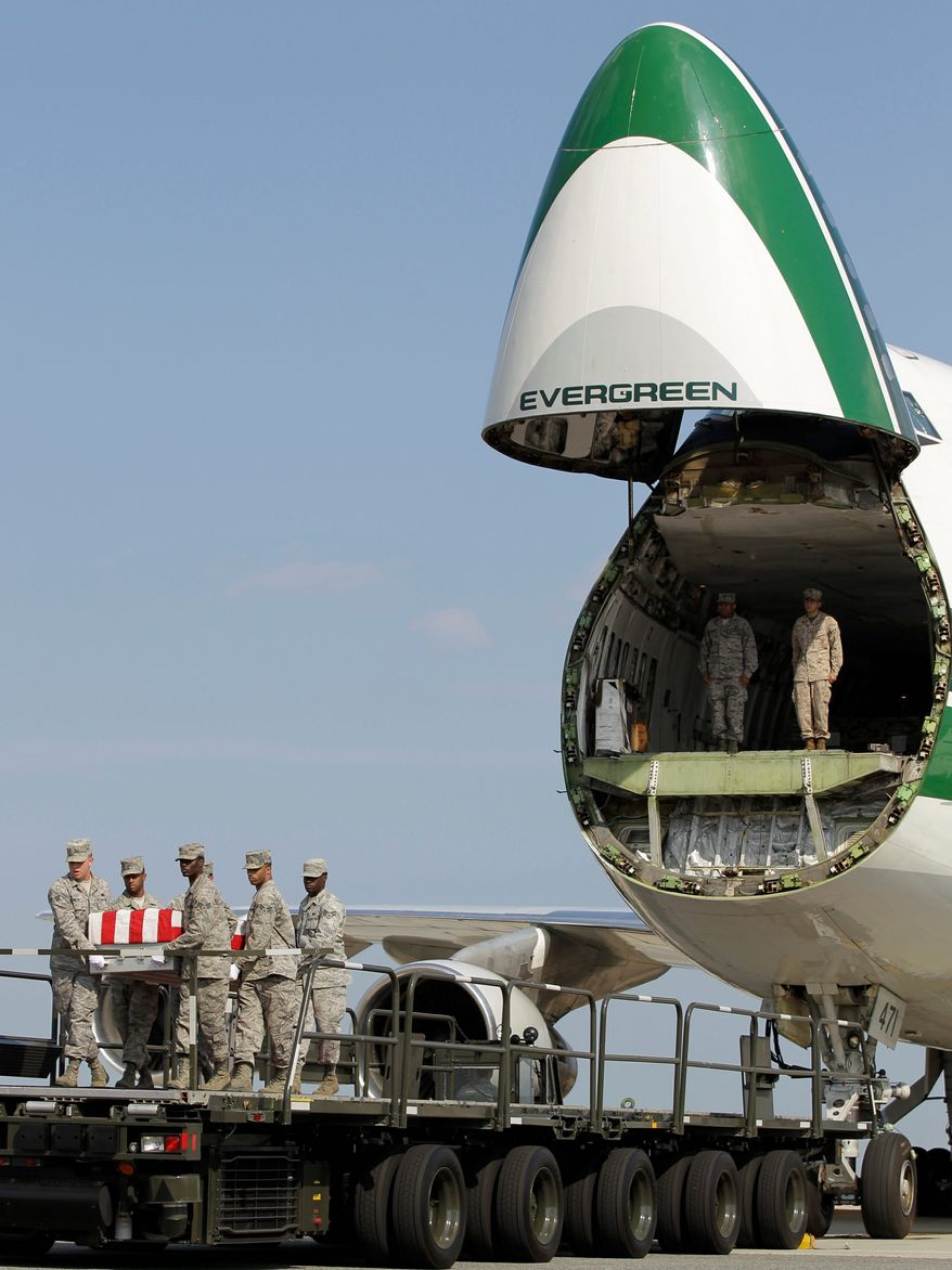 An Air Force carry team moves a transfer case containing the remains of Lance Cpl. Gregory T. Buckley, 21, of Oceanside, N.Y., Monday, Aug. 13, 2012, at Dover Air Force Base, Del. (Associated press)