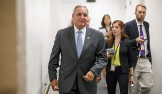 **FILE** House Veterans Affairs' Committee Chairman Jeff Miller, Florida Republican, leaves a Republican caucus meeting, on Capitol Hill in Washington, Friday, July 25, 2014, on the influx of illegal immigrants at the U.S.-Mexico border. With Congress scheduled to recess in a week, Miller and Sen. Bernie Sanders, I-Vt., chairman of the Senate Veterans Affairs Committee, have offered competing proposals to fix the veterans' health care program that has been scandalized by long patient wait times and falsified records covering up the delays. (Associated Press)