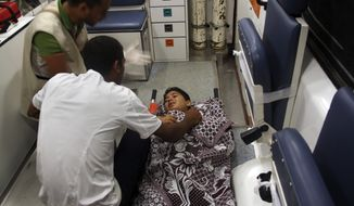 A Palestinian child, who was injured in the war in Gaza, is prepared to be moved by ambulance from a hospital in north Sinai to Cairo after crossing the Gaza Egypt border on Saturday, in el-Arish, Egypt, early Sunday, July 27, 2014. Hamas on Sunday agreed to observe a 24-hour humanitarian truce after initially rejecting such an offer by Israel, as fighting resumed and the two sides wrangled over the terms of a lull the international community hopes can be expanded into a more sustainable truce. (AP Photo/Muhamed Sabry)