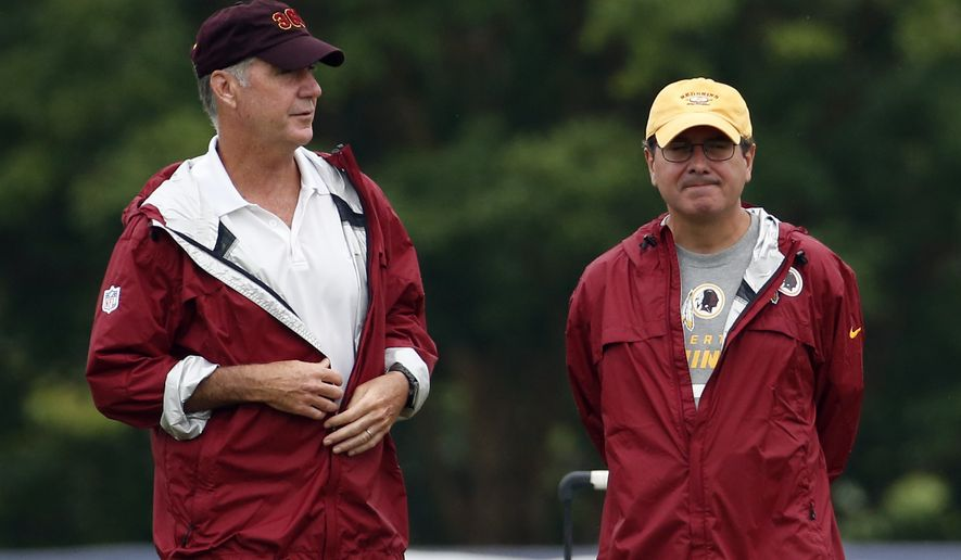 Washington Redskins president and general manager Bruce Allen, left, stands with owner Daniel Snyder during practice at the team's NFL football training facility, Sunday, July 27, 2014 in Roanoke, Va. (AP Photo/Alex Brandon)
