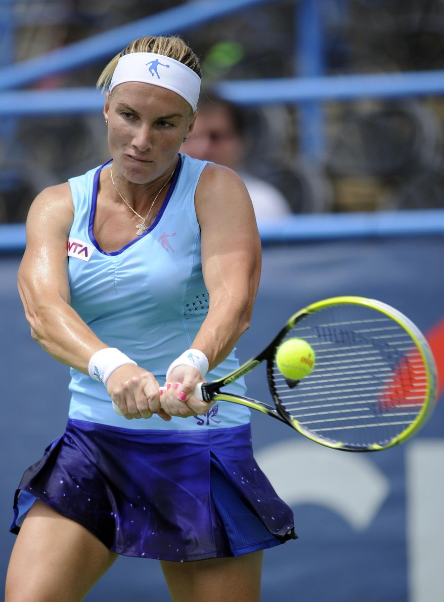 Svetlana Kuznetsova, of Russia, returns the ball against Polona Hercog, of Slovenia, during a match in the Citi Open tennis tournament, Monday, July 28, 2014, in Washington. (AP Photo/Nick Wass)