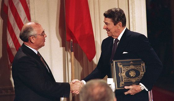 President Reagan and Soviet leader Mikhail Gorbachev signed the Intermediate Range Nuclear Forces Treaty in 1987 to ban missiles with ranges of 310 miles to 3,400 miles. Key members of Congress have told President Obama that Russia is material breach of the treaty. (Associated Press/File)
