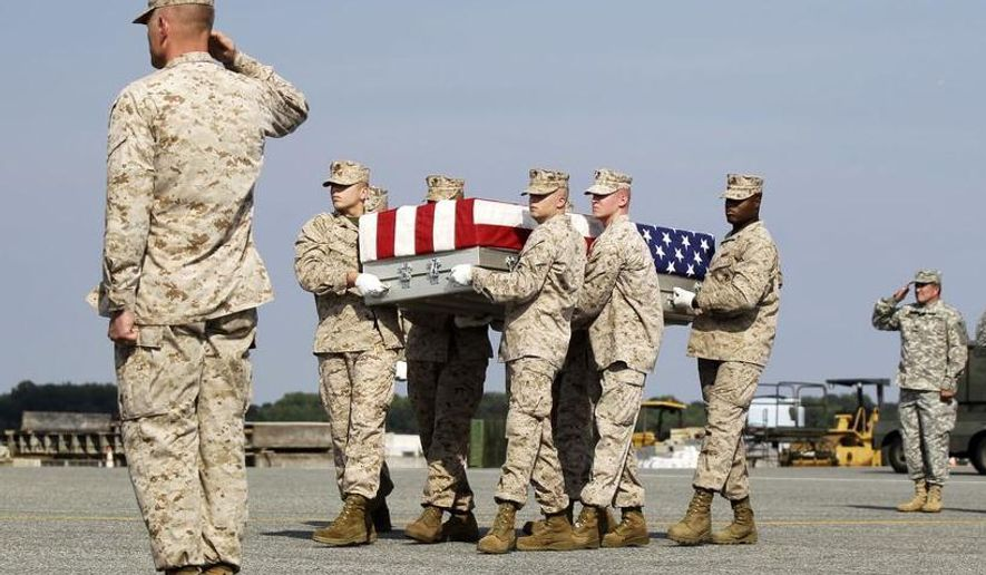 A Marine carry team moves a transfer case containing the remains of Lance Cpl. Gregory T. Buckley, 21, of Oceanside, N.Y., Monday, Aug. 13, 2012, at Dover Air Force Base, Del. According to the Defense Department, Buckley, died Aug. 10 while supporting combat operations in Helmand province, Afghanistan. (AP Photo/Luis M. Alvarez)