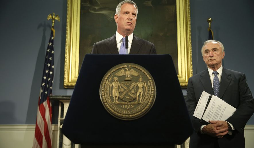 New York City mayor Bill de Blasio, left, and police commissioner Bill Bratton speak to reporters during a news conference on Monday, July 28, 2014 in New York. (AP Photo/Seth Wenig)