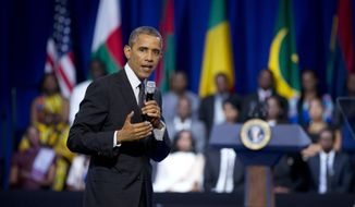 President Barack Obama speaks to participants of the Presidential Summit for the Washington Fellowship for Young African Leaders in Washington, Monday, July 28, 2014, during a town hall meeting. (AP Photo/Manuel Balce Ceneta)