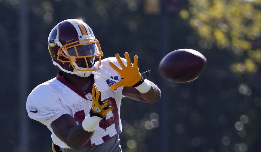 Washington Redskins receiver Rashad Ross catches a pass during practice at the team's NFL football training facility, Monday, July 28, 2014 in Richmond, Va. (AP Photo/Alex Brandon)