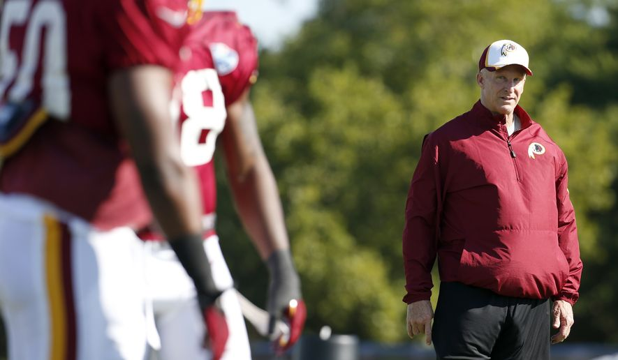 Washington Redskins defensive coordinator Jim Haslett watches during practice at the team's NFL football training facility, Monday, July 28, 2014 in Richmond, Va. (AP Photo/Alex Brandon)