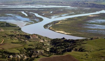 In this June 12, 2014 aerial photo, the Missouri River winds through the countryside near Williston, N.D. The epicenter of the oil boom is a 45-mile stretch of U.S. Route 85 in North Dakota between the towns of Williston and Watford City. (AP Photo/Charles Rex Arbogast)