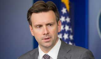 "White House press secretary Josh Earnest said ""not that I'm aware of,"" when asked Tuesday whether the administration had coordinated with Democratic fundraising groups to gin up impeachment scares. (associated press photographs)"