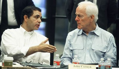 Sen. John Cornyn, right, and Rep. Henry Cuellar, both of Texas, introduced the Helping Unaccompanied Minors and Alleviating National Emergency (HUMANE) Act, designed to accelerate the processing of unaccompanied alien children from Central America. (associated press/the monitor)