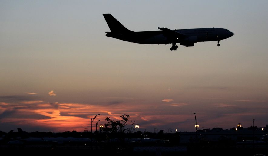 In this April 25, 2012, file photo, an airplane lands at Newark Liberty International Airport in Newark. More travelers are flying than ever before, creating a daunting challenge for airlines: continue to keep passengers safe in an ever more crowded airspace. (AP Photo/Julio Cortez, File)