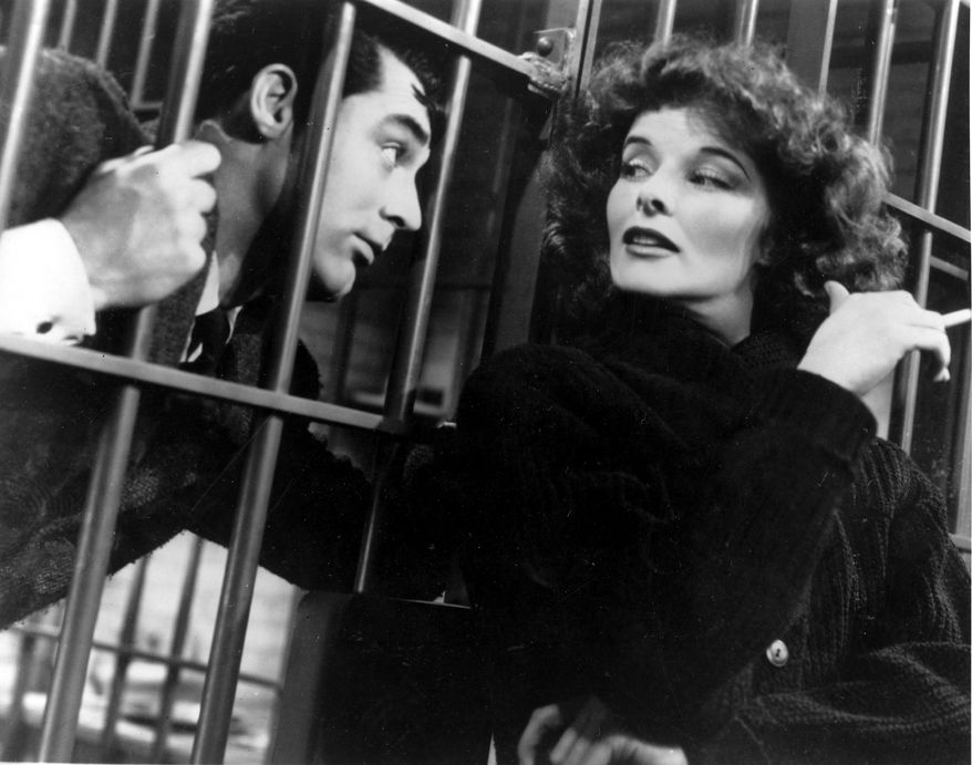 "Actress Katharine Hepburn is shown in character with Cary Grant in a scene from ""Bringing Up Baby"" in 1938.   (AP Photo)"