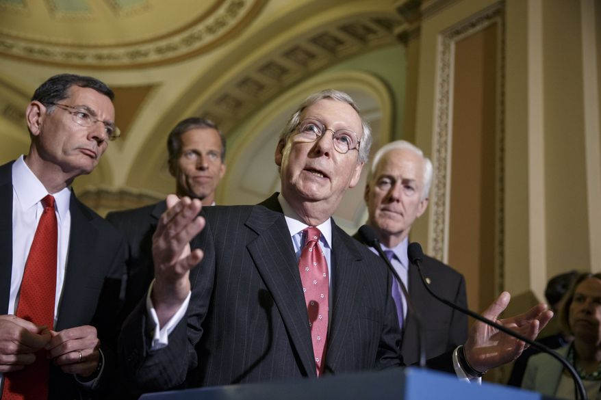 Senate Minority Leader Mitch McConnell of Ky., joined by from left,  Sen. John Barrasso, R-Wyo., Sen. John Thune, R-S.D., and Senate Minority Whip John Cornyn of Texas, talks with reporters after a GOP caucus meeting on Capitol Hill in Washington, Tuesday, July 29, 2014. Democrats and Republicans in Congress vowed urgent support for a $225 million missile defense package for Israel, boosting the likelihood that legislation will clear Congress before lawmakers begin a monthlong vacation at week's end.  (AP Photo/J. Scott Applewhite)