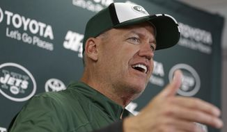New York Jets head coach Rex Ryan responds to questions during a news conference at NFL football training camp Friday, July 25, 2014, in Cortland, N.Y.  (AP Photo)