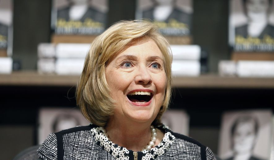 "Former U.S. Secretary of State Hillary Clinton greets a customer during a book signing of her new book ""Hard Choices"" at Northshire Bookstore on Tuesday, July 29, 2014, in Saratoga Springs, N.Y. Clinton is making selected stops to promote her book about her four years heading the State Department under President Barack Obama.  (AP Photo/Mike Groll)"