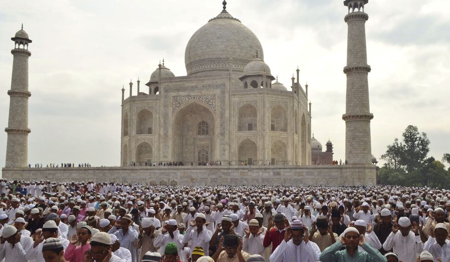Indian Muslims offer prayers at a mosque in the premises of the Taj Mahal in Agra, India, Tuesday, July 29, 2014. Millions of Muslims across the world are celebrating the Eid al-Fitr holiday, which marks the end of the monthlong fast of Ramadan. (AP Photo/Pawan Sharma) ** FILE **