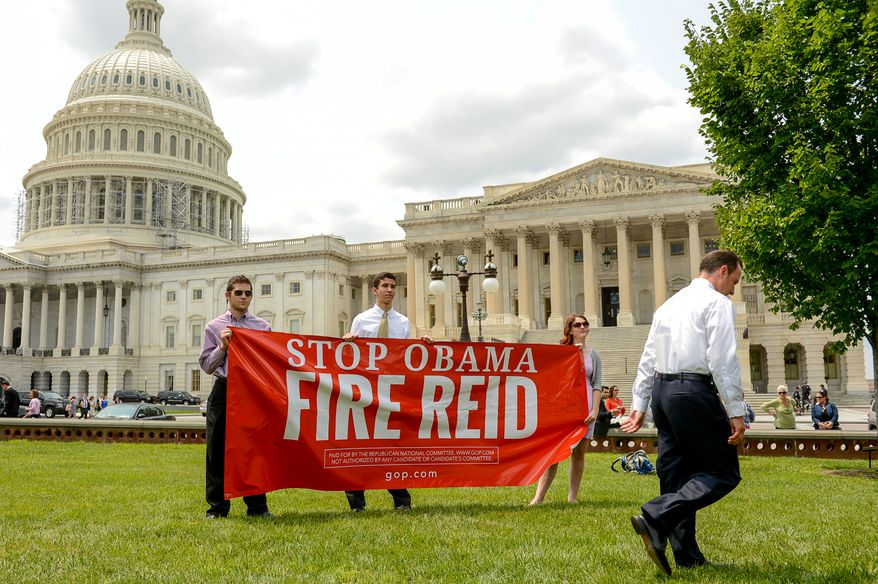 "Interns with the Republican National Committee and the Republican National Congressional Committee hold a banner that reads, ""Stop Obama Fire Reid"" as RNC Chairman Reince Priebus, right, leaves following a FireReid Campaign to protest against the ""failed leadership of Senate Majority Leader Harry Reid held by the Republican National Committee and the Republican National Congressional Committee on the east side of the U.S. Capitol Building, Washington, D.C., Tuesday, July 29, 2014. (Andrew Harnik/The Washington Times)"