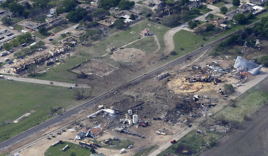 This April 18, 2013 file photo shows an aerial view of the remains of a fertilizer plant and an apartment complex to the left, destroyed by an explosion in West, Texas.  The government has failed to inspect virtually all of the chemical facilities that it considers to be at high risk for a terror attack, numbering in the thousands, and has underestimated the threat to densely populated cities, congressional investigators say.  (AP Photo/Tony Gutierrez, File)