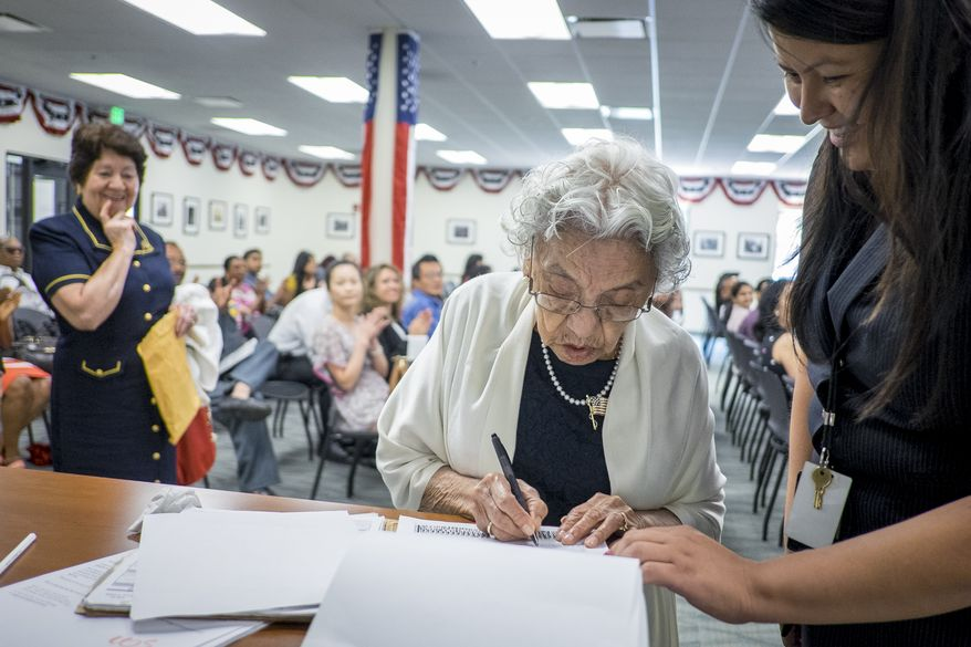 The backlog of applications at U.S. Citizenship and Immigration Services has more than doubled during the 18 months surrounding the election. (The Washington Times/File)