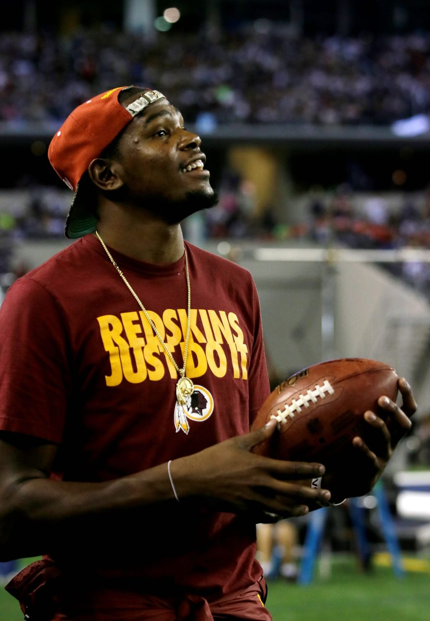 Washington Redskins fan Kevin Durant, of the Oklahoma City Thunder NBA basketball team, before an NFL football game against the Dallas Cowboys Sunday, Oct. 13, 2013, in Arlington, Texas. (AP Photo/Tim Sharp)