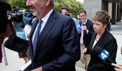 Jerri Fulkerson, Jonnie Williams' assistant (right), follows a path cleared by her attorney George Terwilliger as she left federal court after completing her testimony in the corruption trial of former Virginia Gov. Bob McDonnell and his wife Maureen on Wednesday. (Associated Press)