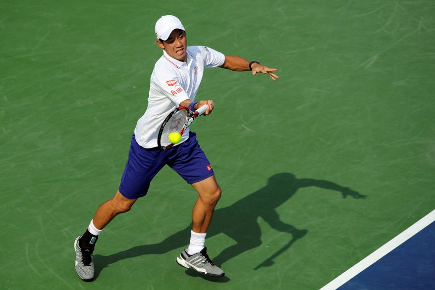 Fourth seed Kei Nishikori returns the ball to Sam Querrey in his 6-4, 5-7, 6-4 victory at the Citi Open on Wednesday in the District. Players like Nishikori hope to use the Citi Open as a springboard in moving up the ATP rankings and narrow the gap between them and the top five players in the world. (Associated Press)