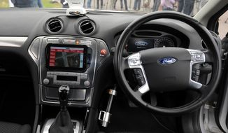 The interior of a driverless car during testing at the headquarters of motor industry research organization MIRA at Nuneaton in the West Midlands, England, Wednesday, July 30, 2014. British officials says driverless cars will be tested on roads in as many as three cities in a trial program to begin in January. Officials said Wednesday the tests will last up to three years. Sensors and cameras will guide the cars. (AP Photo/PA, Rui Vieira)