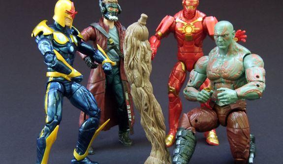 Hasbro's Marvel Legends Infinite Series Guardians of the Galaxy Nova, Star-Lord, Iron Man and Drax admire Groot's Build-a-figure leg.  (Photo by Joseph Szadkowski / The Washington Times)